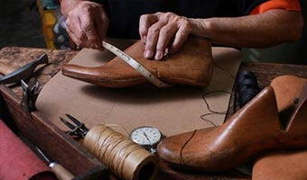 repairing brown leather shoes
